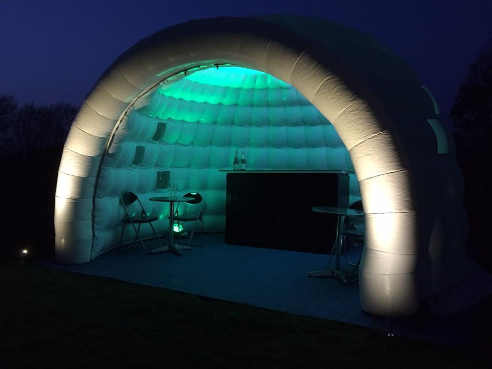 igloo bar lit up in green